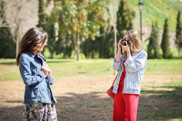 Two young tourist women taking photographs outdoors © javiindy