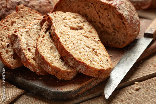 fresh baked sliced bread on wooden background