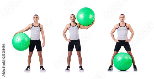 Leinwandbild Motiv Man with swiss ball doing exercises on white