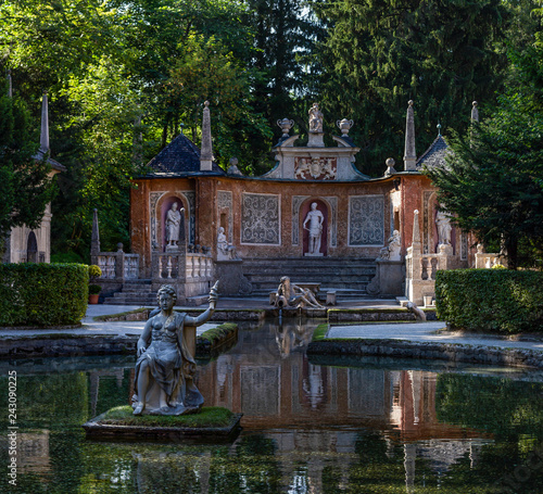 Sculptures at the Water Pond in Public Gardens of Hellbrunn Palace in Salzburg Austria