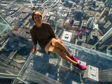 Tourists posing on a glass floor - 243094250
