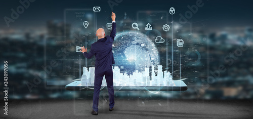 Leinwanddruck Bild Businessman in front of a wall with Smart city user interface with icon, stats and data 3d rendering