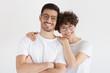 Leinwandbild Motiv Cheerful young couple standing isolated on gray background