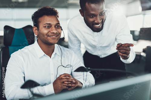Two cheerful operators working on dispatch board
