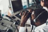 Young air dispatcher looking at binocular far away - 243123607