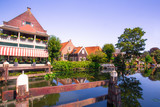 Scene from picturesque cheese-making town of Edam, Holland with historic architecture and canal - 243124457