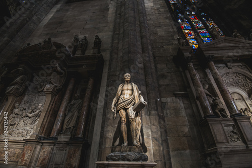 MILAN, ITALY - AUGUST 20, 2018: St. Bartholomew statue in Duomo di Milano (Dome of Milan), Milan, Italy. St Bartholomew was one of 12 Apostles and an early Christian martyr that was skinned
