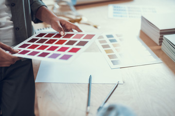 Afro american young woman working with color samples
