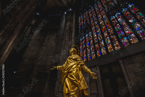 Milan, Italy - AUGUSTA 18, 2018: Interior of Milan Cathedral Duomo. Statue of golden Madonna