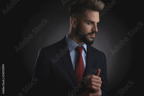 Leinwanddruck Bild portrait of attractive smart casual man looking to side