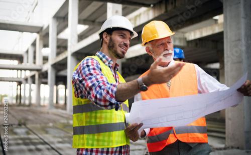 Leinwandbild Motiv Group of construction engineer working in construction site
