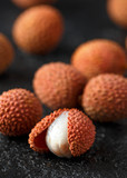 Tropical Lychee fruits, soapberry on rustic black table, background - 243140856