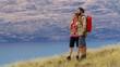 Young male female trekking Mount Aspiring New Zealand