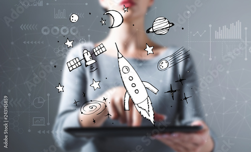 Leinwandbild Motiv Dream of space and rocket with business woman using a tablet computer