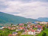 Montenegro, Herceg Novi. Tiled roofs of old town at background of the Adriatic Sea, mountains, cruise liner. - 243150269