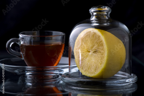 half a lemon in a glass vase