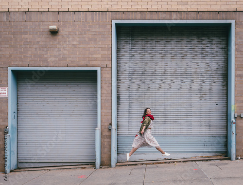Jumping young girl on the street