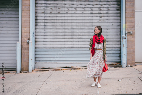 Attractive girl with a red scarf on the street