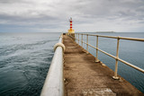 The Pier Lighthouse in Amble in Northumberland, England, UK, seen from the South Pier
