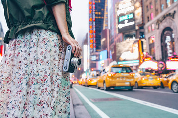 Young girl with a retro camera in New York City