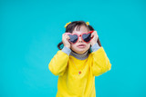 Little girl with genetic disorder posing in funky glasses