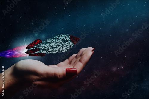 Human hand holding Rocket. Nebula dust. Mixed media.
