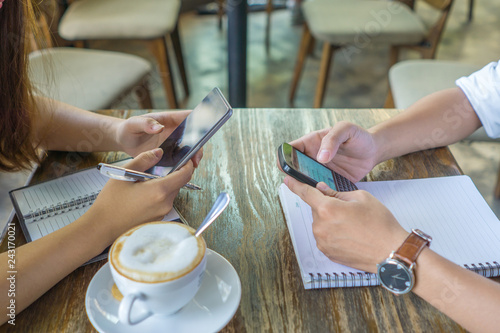 Close-up of human hands using smartphone while having conversation