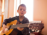 Boy enjoying playing guitar