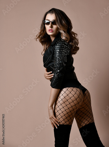 Beautiful sexy woman with nice ass buttocks in modern leather jacket and fashion sunglasses - 243187463
