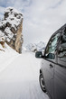 canvas print picture - Driving along a snowcapped pass