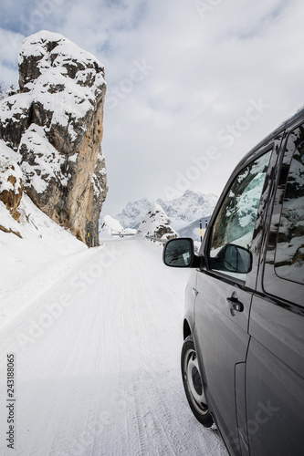 canvas print picture Driving along a snowcapped pass