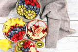 fruit bowl. Bowl of healthy fresh fruit salad on rustic background
