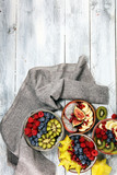 fruit bowl. Bowl of healthy fresh fruit salad on rustic background