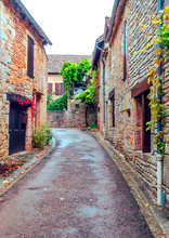 "Постер, картина, фотообои ""Medieval village of Aquitaine with its stone houses in the south of France on a cloudy day."""