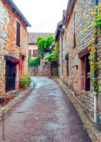Medieval village of Aquitaine with its stone houses in the south of France on a cloudy day.