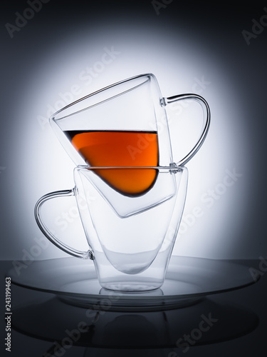 Still life of two cups of tea on a white background, with thin outlines of cups.