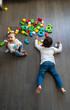 Leinwandbild Motiv Two happy baby playing with toy blocks.