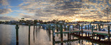 Harbor with boats at golden hour as day breaks over the North Gulf Shore Harbor - 243224662