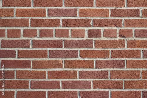 Grungy vintage reddish brown brick wall in common bond pattern - 243225844