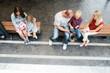 Leinwandbild Motiv Phone addicted family using their phones at a mall