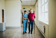 Leinwanddruck Bild - Physiatrist training a patient to walk again