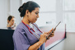 Leinwanddruck Bild - Female nurse checking the schedule on a tablet