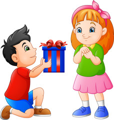 Little boy gives gift to girl © idesign2000