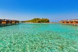 Bungalows on tropical Maldives island - 243247644
