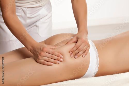 Leinwanddruck Bild anti-cellulite massage on the legs of young women