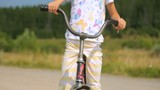 Little girl with bicycle - 243254069