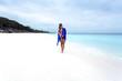 Woman on beach with Aussie flag draped around her