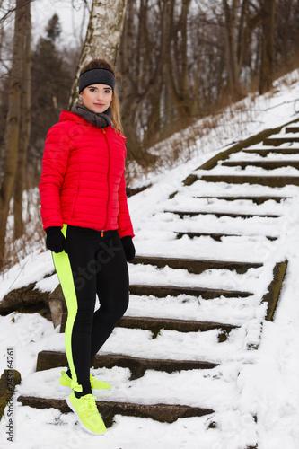 Foto Murales Woman wearing sportswear exercising during winter