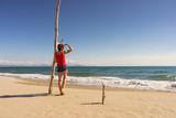 Tourist woman on beach enjoying vacation - 243264409