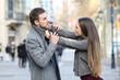 Leinwandbild Motiv Angry couple fighting in the street